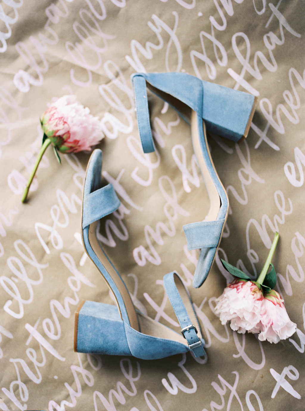 blue wedding shoes - photo by Awake Photography https://ruffledblog.com/sweet-peony-bridal-inspiration