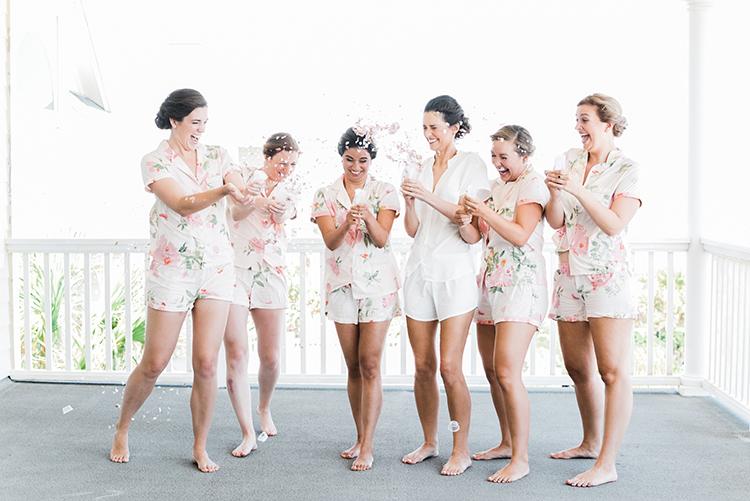 bridesmaids with confetti - https://ruffledblog.com/swoon-worthy-charleston-wedding-with-spanish-moss