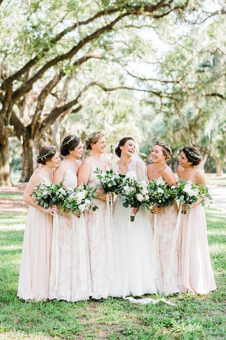 blush pink bridesmaid dresses - https://ruffledblog.com/swoon-worthy-charleston-wedding-with-spanish-moss