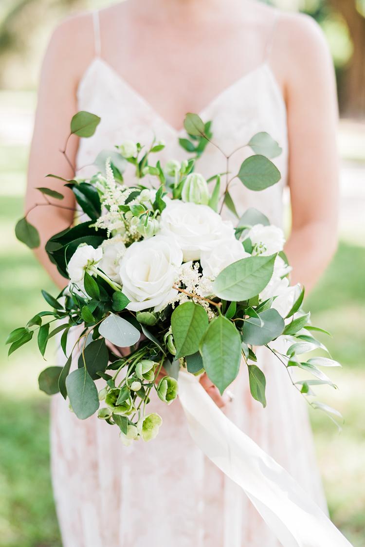 leafy bridesmaid bouquets - https://ruffledblog.com/swoon-worthy-charleston-wedding-with-spanish-moss