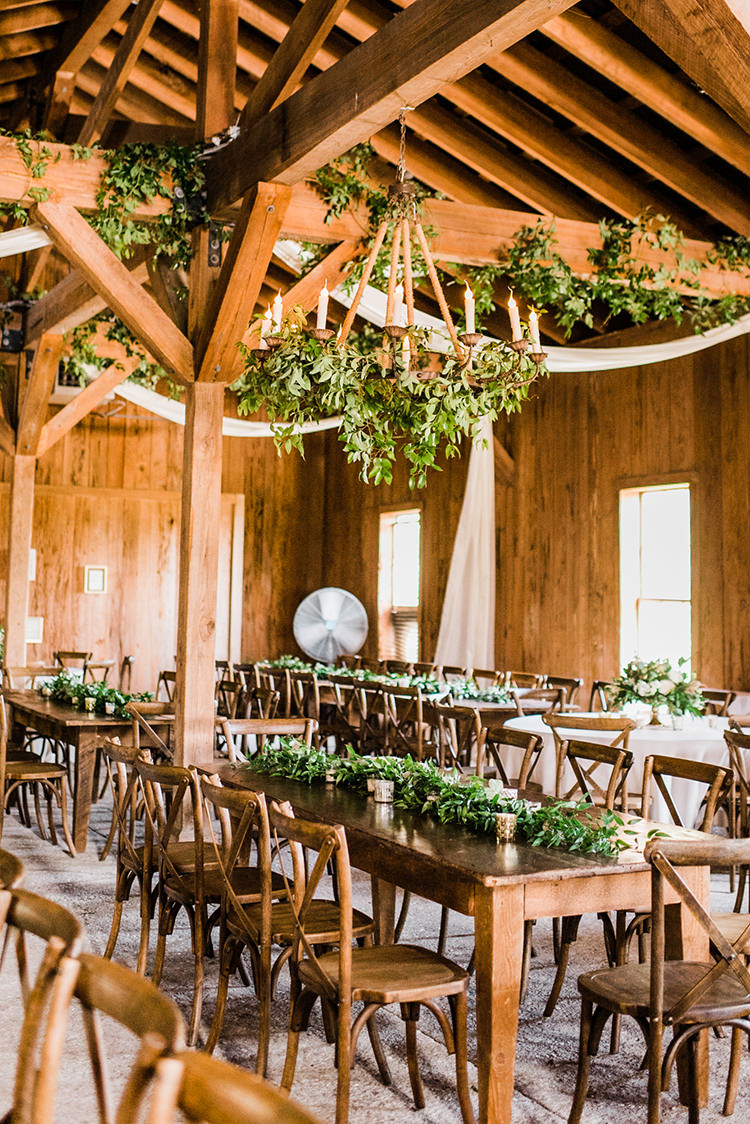 rustic wedding receptions with greenery - https://ruffledblog.com/swoon-worthy-charleston-wedding-with-spanish-moss