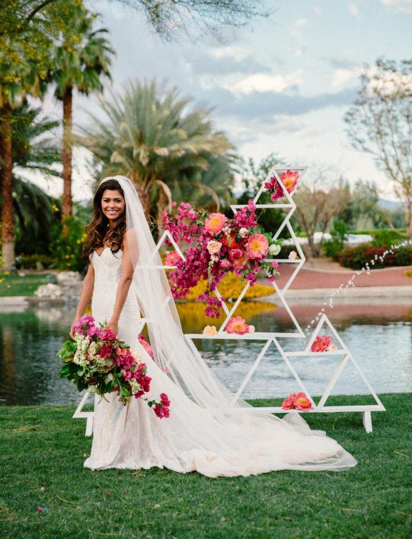 geometric and bougainvillea backdrop - photo by The Melideos http://ruffledblog.com/40-eye-catching-geometric-wedding-ideas