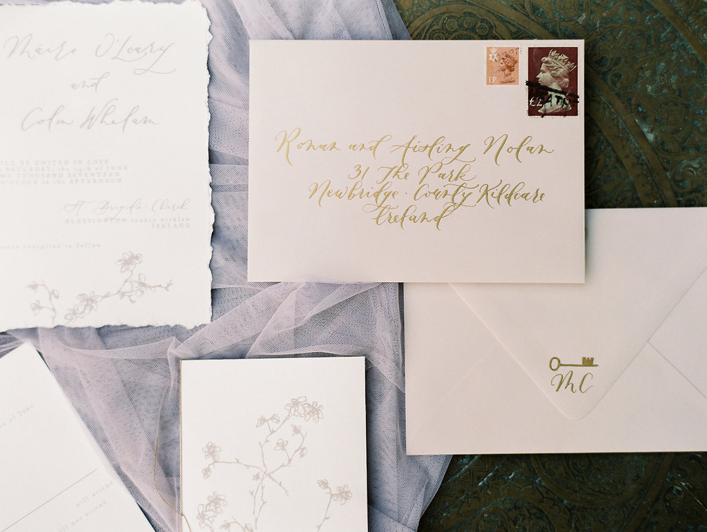 wedding stationery with gold calligraphy - photo by As Ever Photography http://ruffledblog.com/the-secret-garden-inspired-wedding-in-ireland