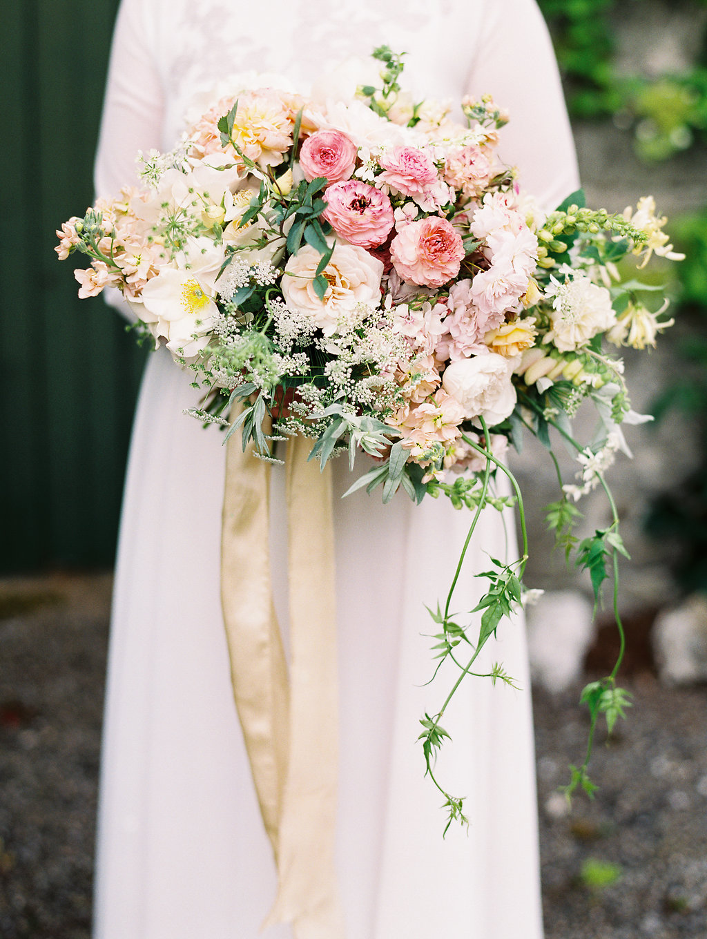 romantic pink and yellow bouquets - photo by As Ever Photography http://ruffledblog.com/the-secret-garden-inspired-wedding-in-ireland