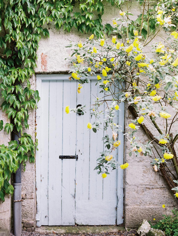 blue doors - photo by As Ever Photography https://ruffledblog.com/the-secret-garden-inspired-wedding-in-ireland