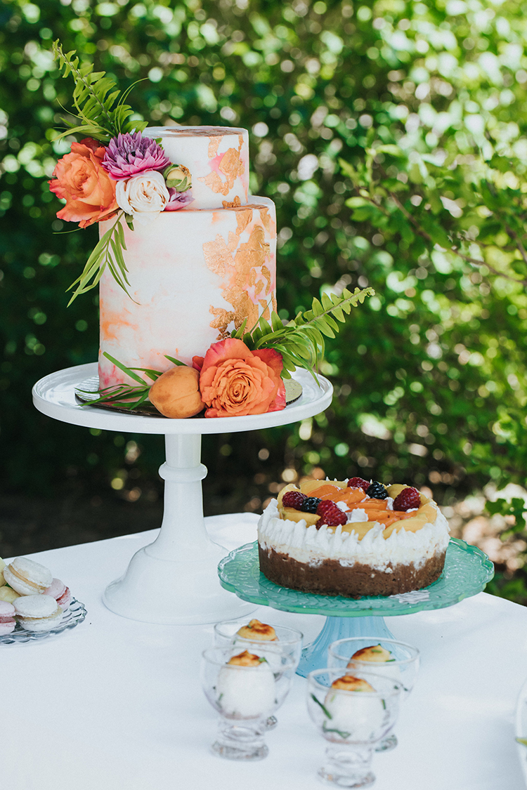 wedding cake with copper accents - photo by Shutterfreek https://ruffledblog.com/throw-a-tropical-bridal-shower-with-these-free-printable-invites