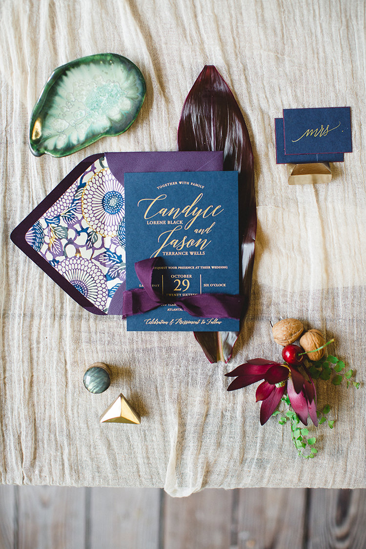 purple and blue wedding stationery - https://ruffledblog.com/tropical-glamping-wedding-inspiration-with-moody-hues