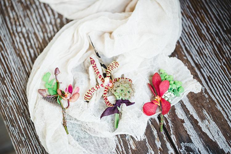 tropical inspired boutonnieres - https://ruffledblog.com/tropical-glamping-wedding-inspiration-with-moody-hues