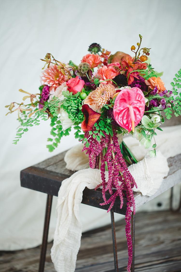 tropical wedding bouquets - https://ruffledblog.com/tropical-glamping-wedding-inspiration-with-moody-hues