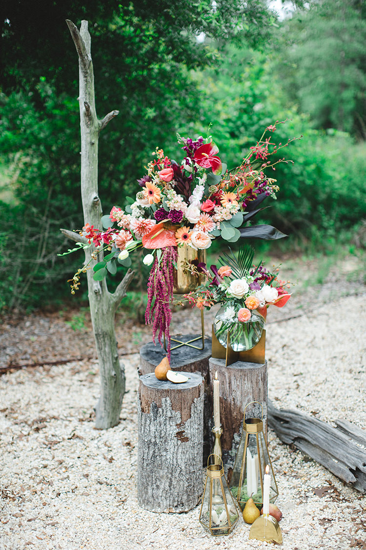 tropical flowers for the wedding ceremony - https://ruffledblog.com/tropical-glamping-wedding-inspiration-with-moody-hues