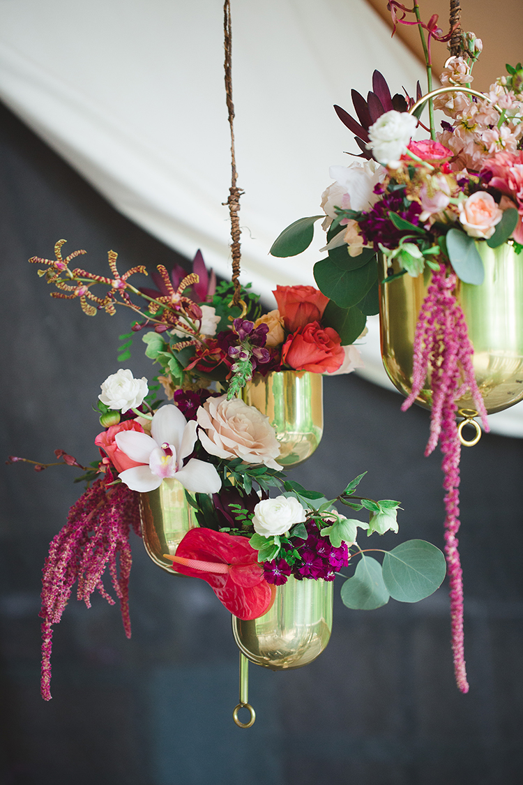 ways to use brass in your wedding - http://ruffledblog.com/tropical-glamping-wedding-inspiration-with-moody-hues