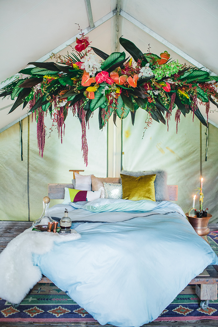 boho bedroom home design with flowers - https://ruffledblog.com/tropical-glamping-wedding-inspiration-with-moody-hues