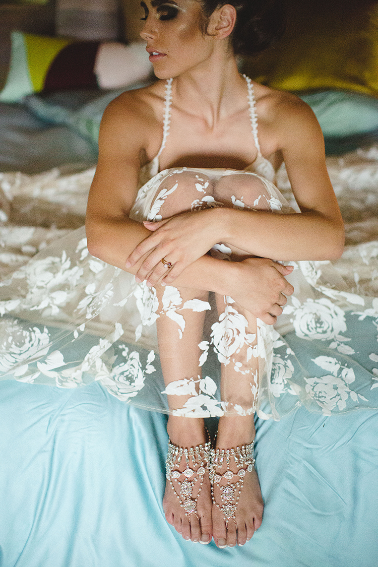 boho lace wedding dresses - https://ruffledblog.com/tropical-glamping-wedding-inspiration-with-moody-hues