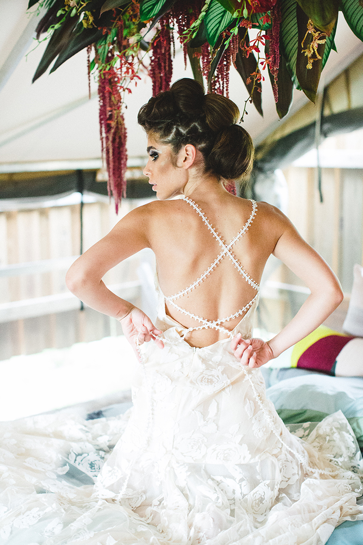 boho strappy back wedding gowns - https://ruffledblog.com/tropical-glamping-wedding-inspiration-with-moody-hues