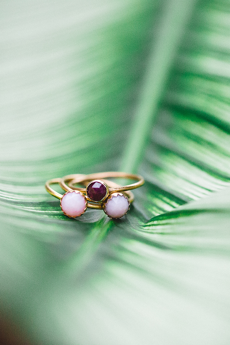unique non diamond engagement rings - http://ruffledblog.com/tropical-glamping-wedding-inspiration-with-moody-hues