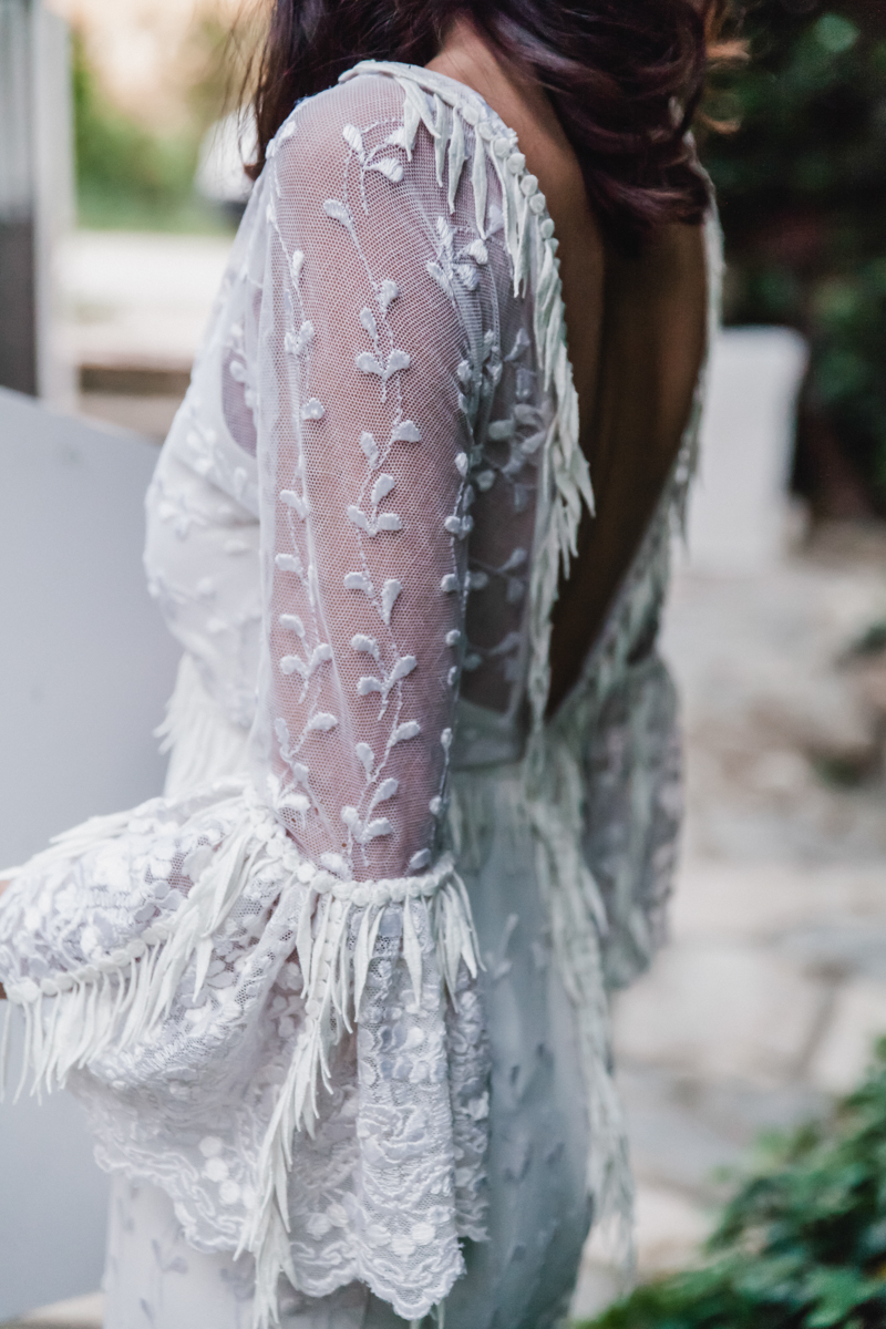 lace wedding dresses with bell sleeves - photo by Sarah and Nora Photographers https://ruffledblog.com/tropical-spanish-wedding-inspiration-with-philodendrons