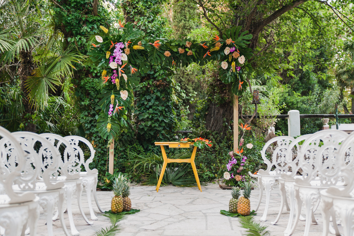 tropical wedding ceremonies - photo by Sarah and Nora Photographers https://ruffledblog.com/tropical-spanish-wedding-inspiration-with-philodendrons