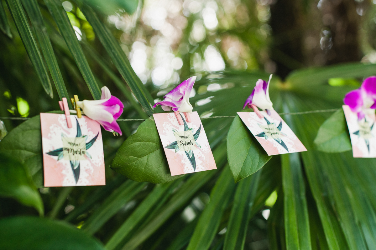 seating chart paper goods - photo by Sarah and Nora Photographers http://ruffledblog.com/tropical-spanish-wedding-inspiration-with-philodendrons