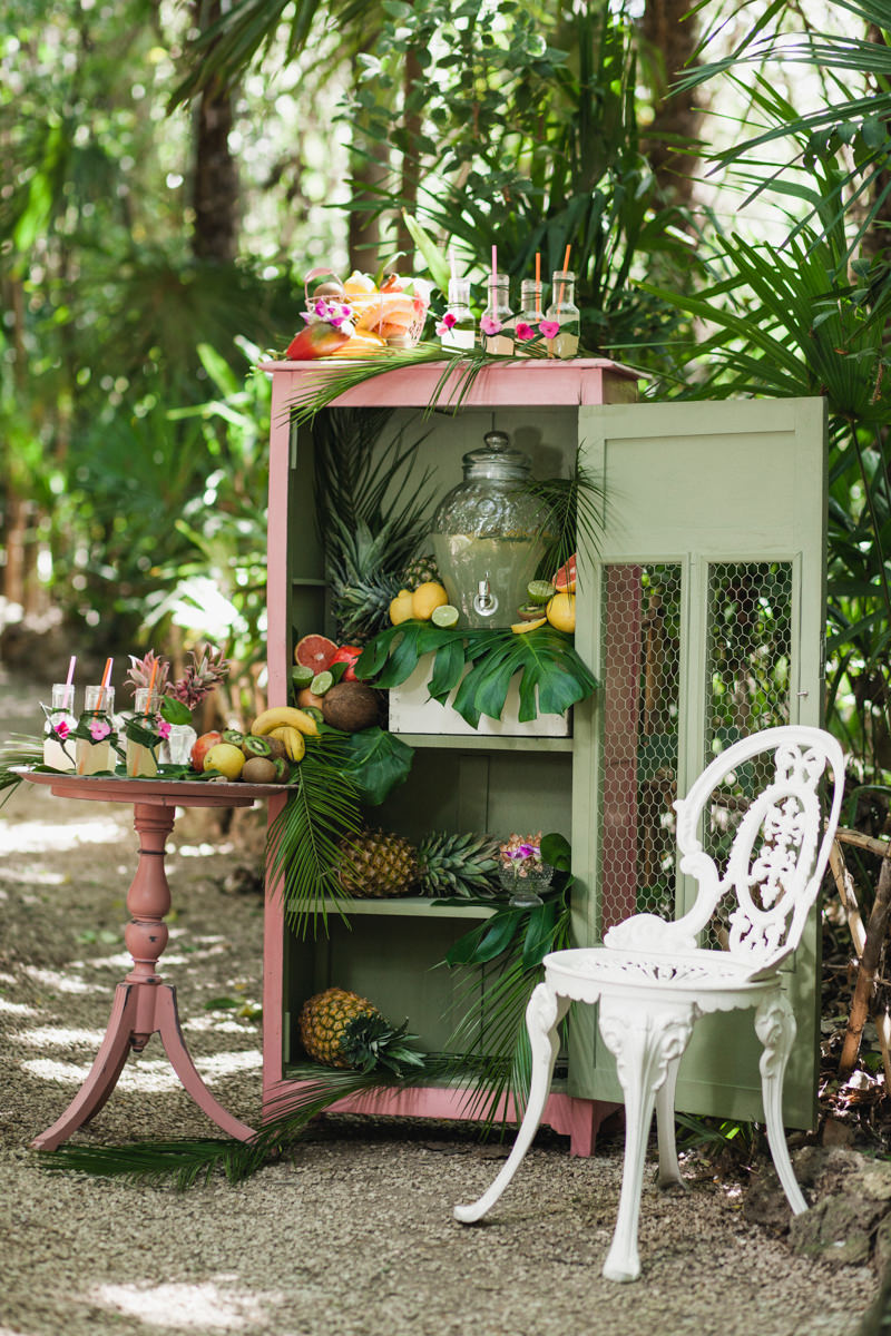 wedding drink displays - photo by Sarah and Nora Photographers https://ruffledblog.com/tropical-spanish-wedding-inspiration-with-philodendrons