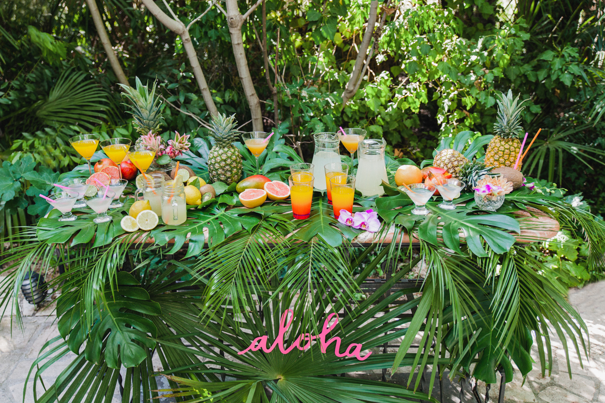 wedding beverage bar - photo by Sarah and Nora Photographers https://ruffledblog.com/tropical-spanish-wedding-inspiration-with-philodendrons