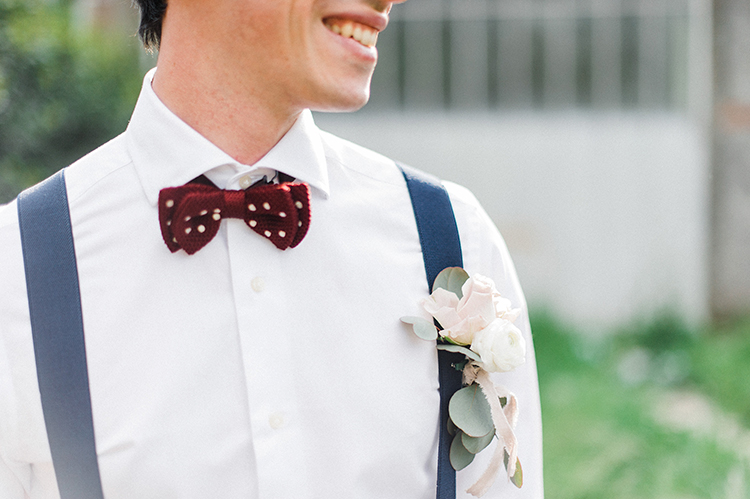 groom looks with suspenders - photo by Linda Nari Photography https://ruffledblog.com/tuscan-warehouse-wedding-inspiration-with-a-floral-bridal-gown