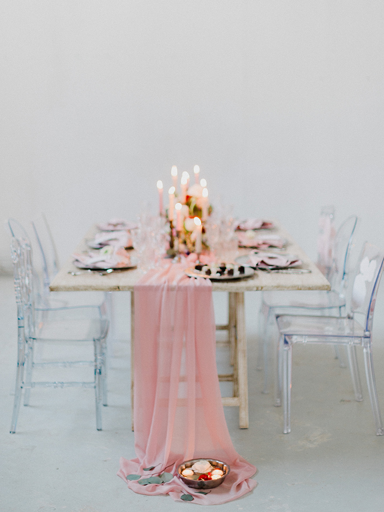 pink fabric table runners - photo by Linda Nari Photography https://ruffledblog.com/tuscan-warehouse-wedding-inspiration-with-a-floral-bridal-gown