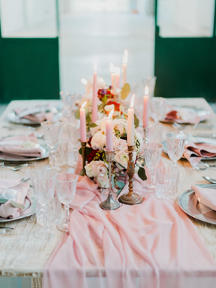 reception tables with pink runners - photo by Linda Nari Photography https://ruffledblog.com/tuscan-warehouse-wedding-inspiration-with-a-floral-bridal-gown