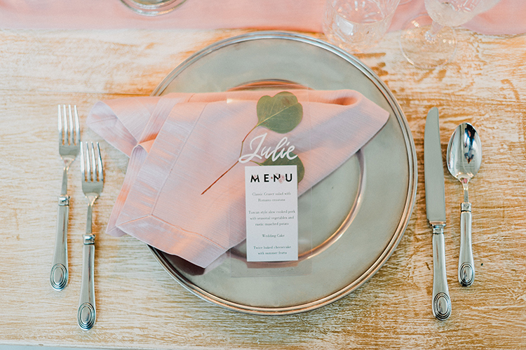 place settings with pink details - photo by Linda Nari Photography http://ruffledblog.com/tuscan-warehouse-wedding-inspiration-with-a-floral-bridal-gown