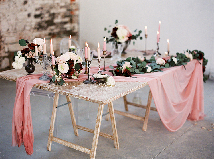 wedding tables with pink details - photo by Linda Nari Photography http://ruffledblog.com/tuscan-warehouse-wedding-inspiration-with-a-floral-bridal-gown