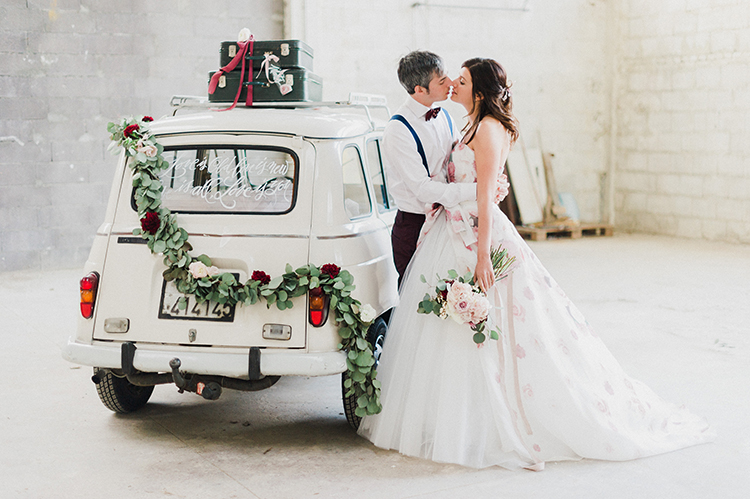 vintage cars at weddings - photo by Linda Nari Photography https://ruffledblog.com/tuscan-warehouse-wedding-inspiration-with-a-floral-bridal-gown