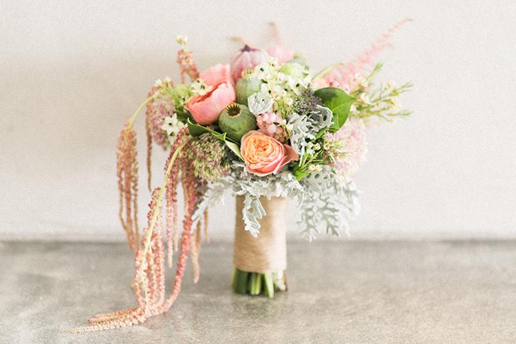 peach bouquets - photo by Adriana Morais https://ruffledblog.com/two-day-destination-wedding-celebration-in-portugal
