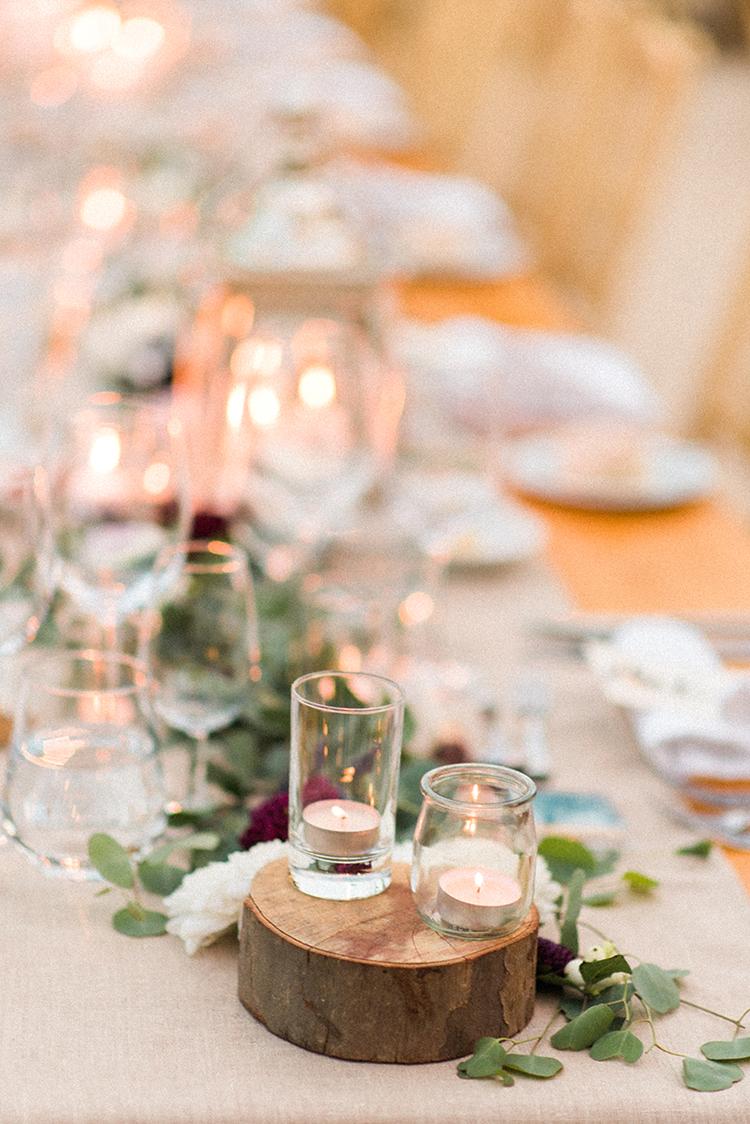 rustic wedding centerpieces - photo by Adriana Morais https://ruffledblog.com/two-day-destination-wedding-celebration-in-portugal
