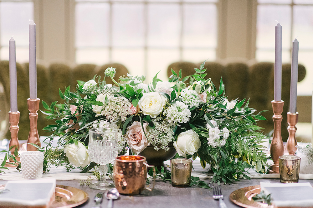 floral centerpieces - photo by Alicia King Photography http://ruffledblog.com/upstate-new-york-wedding-ideas-with-copper