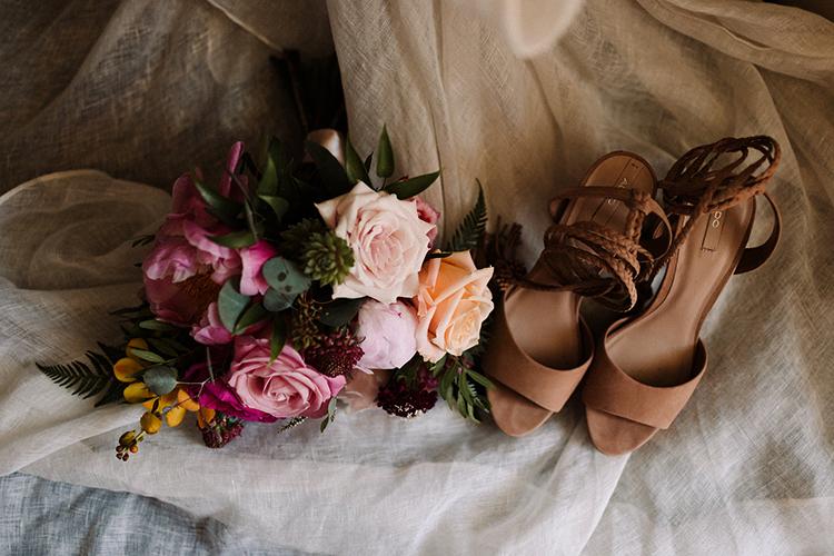 wedding bouquets and shoes - https://ruffledblog.com/urban-chic-art-gallery-wedding-in-ontario