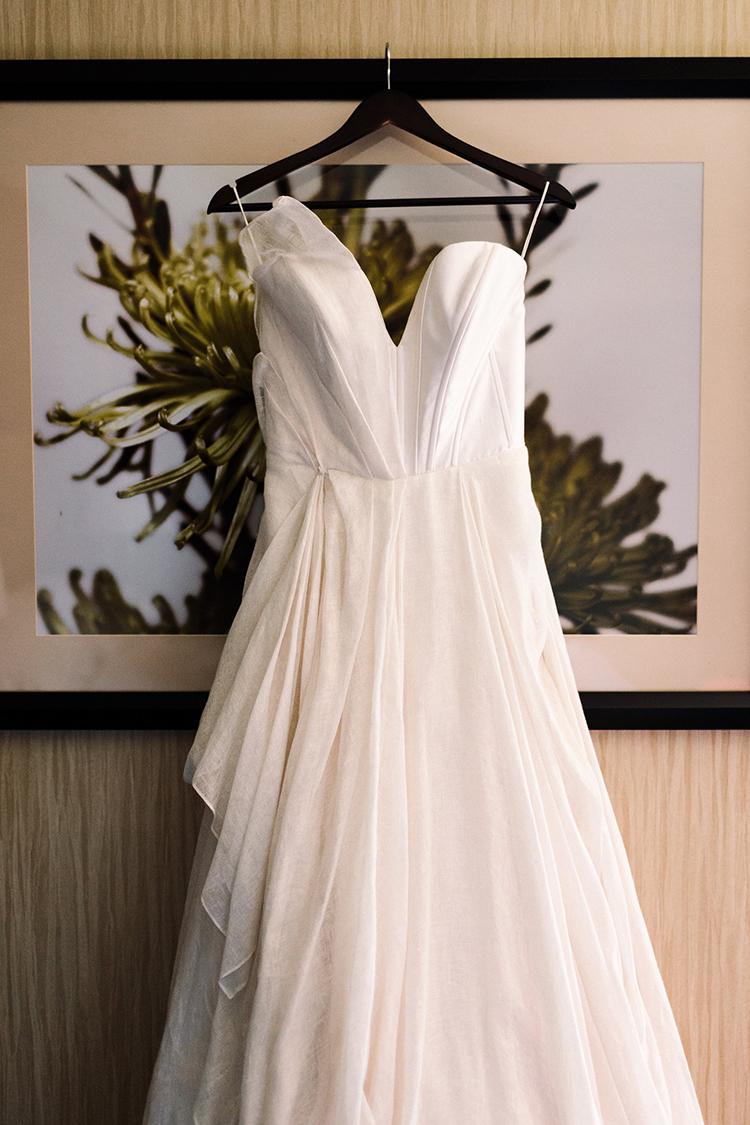 Carol Hannah wedding gowns - https://ruffledblog.com/urban-chic-art-gallery-wedding-in-ontario