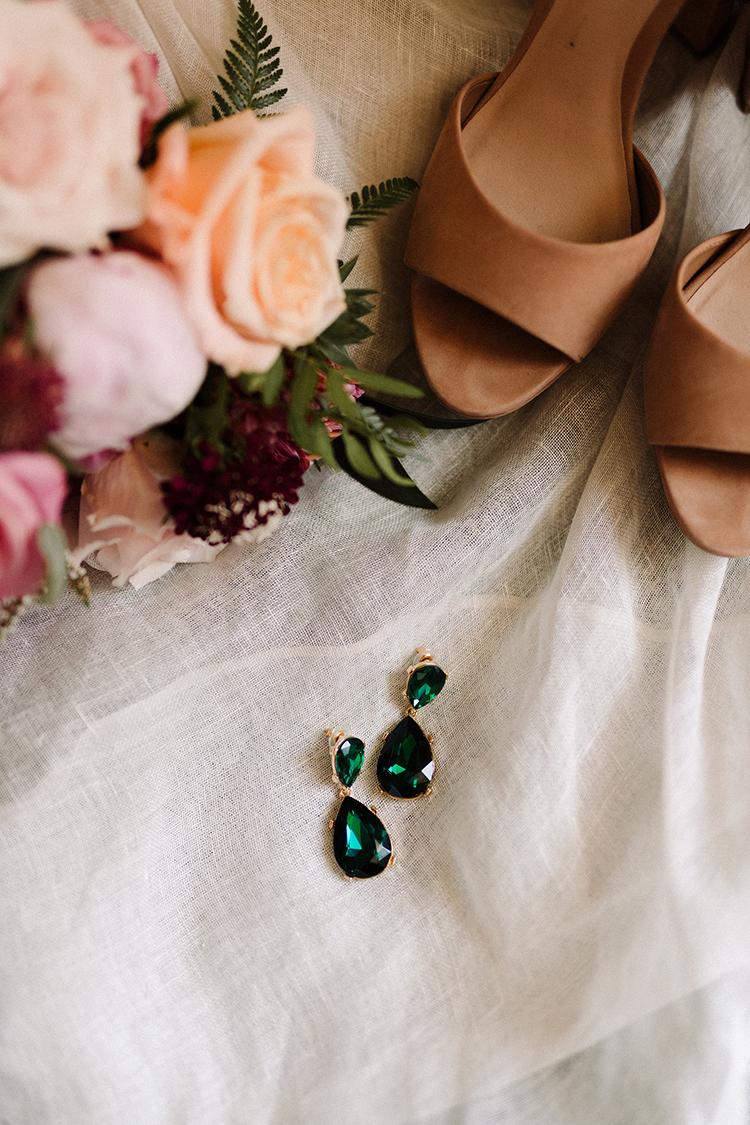 emerald colored bridal earrings - https://ruffledblog.com/urban-chic-art-gallery-wedding-in-ontario