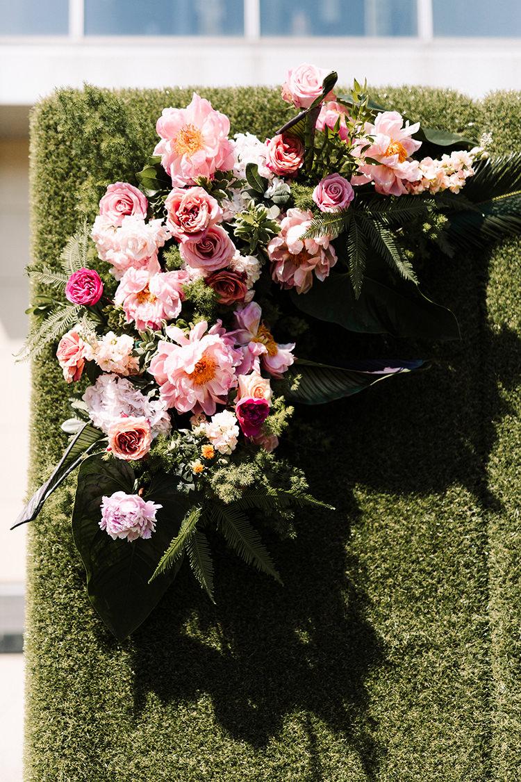 wedding ceremony arch flowers - https://ruffledblog.com/urban-chic-art-gallery-wedding-in-ontario