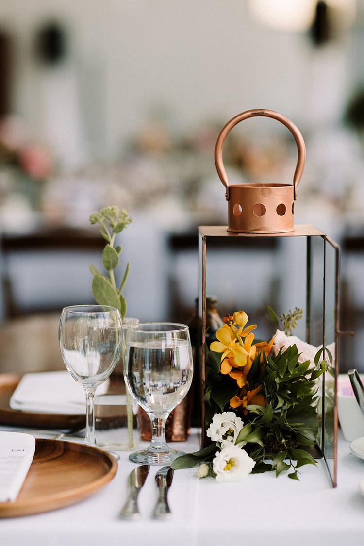 copper lanterns as wedding decor - https://ruffledblog.com/urban-chic-art-gallery-wedding-in-ontario