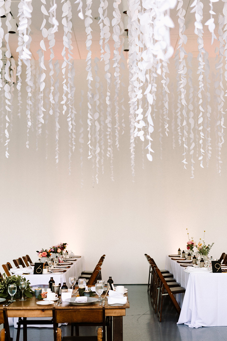 modern wedding decor with hanging white paper accents - https://ruffledblog.com/urban-chic-art-gallery-wedding-in-ontario