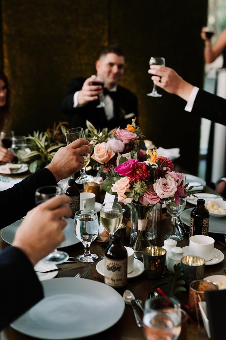 wedding toasts - https://ruffledblog.com/urban-chic-art-gallery-wedding-in-ontario