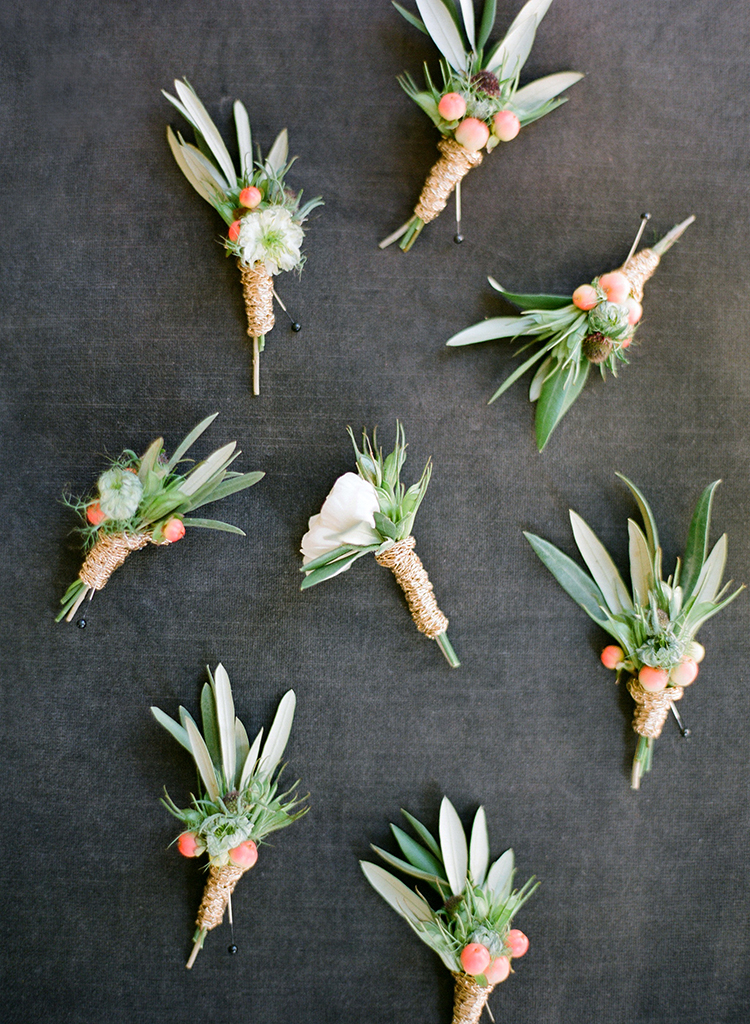 leafy boutonnieres - photo by Lacie Hansen http://ruffledblog.com/utterly-beautiful-california-wedding-planned-by-the-bride