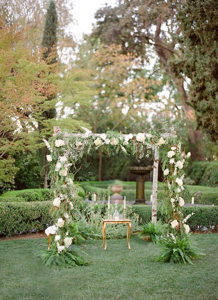 floral ceremony arches - photo by Lacie Hansen http://ruffledblog.com/utterly-beautiful-california-wedding-planned-by-the-bride