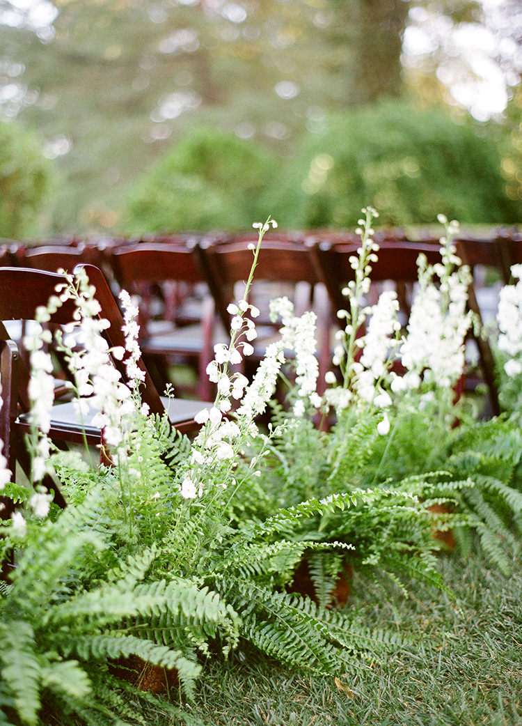wedding ceremony seating flowers - photo by Lacie Hansen https://ruffledblog.com/utterly-beautiful-california-wedding-planned-by-the-bride