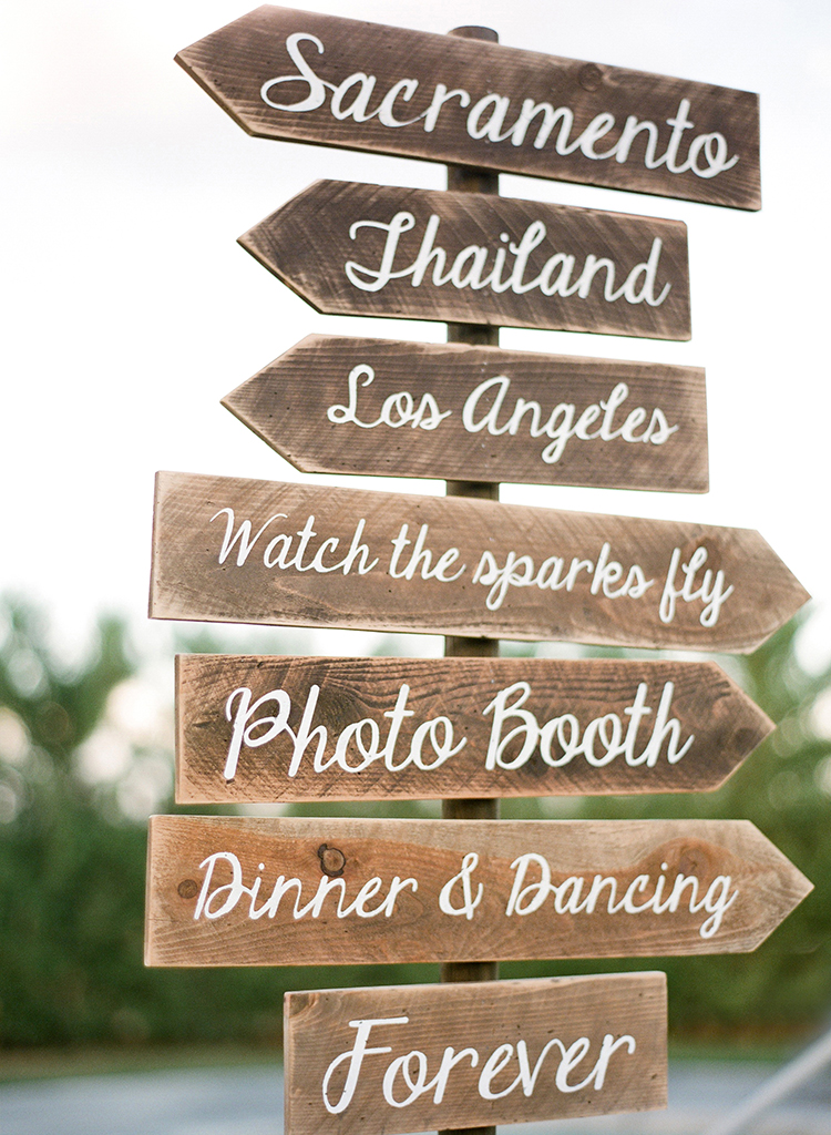 wedding signs - photo by Lacie Hansen https://ruffledblog.com/utterly-beautiful-california-wedding-planned-by-the-bride