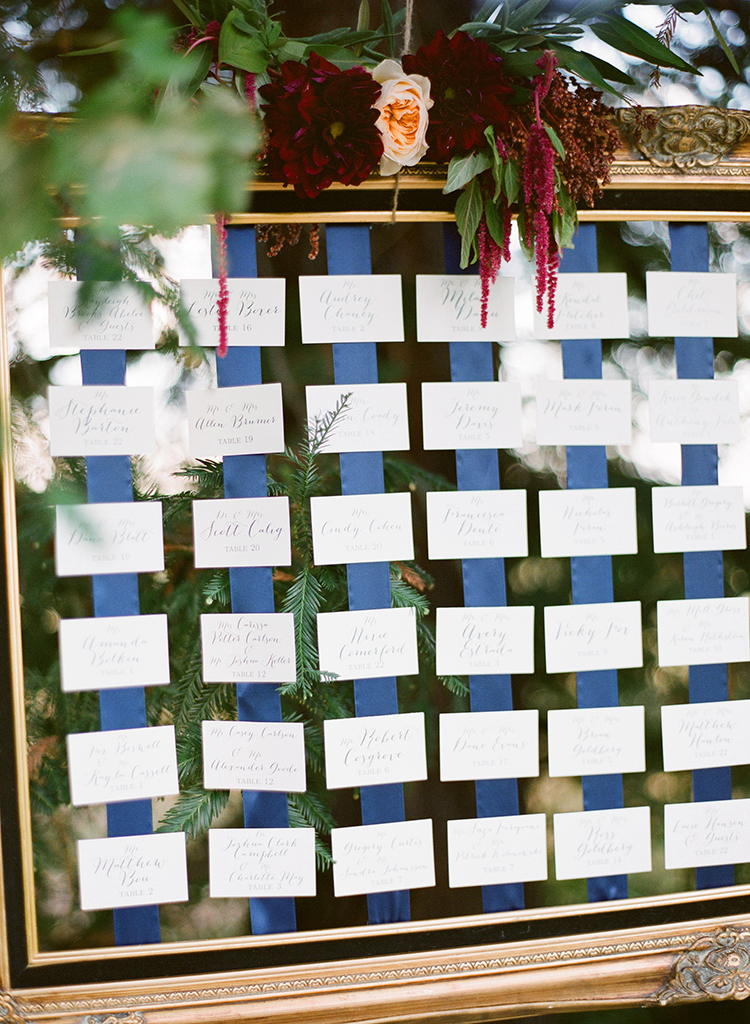 seating charts with ribbons - photo by Lacie Hansen http://ruffledblog.com/utterly-beautiful-california-wedding-planned-by-the-bride