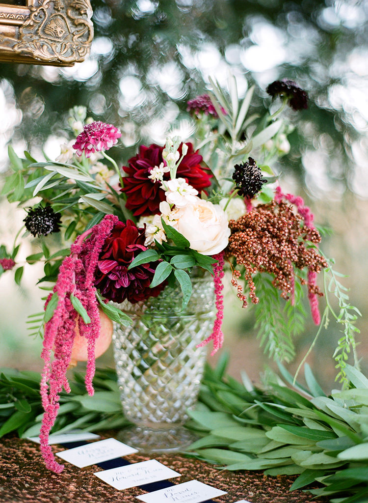 wedding centerpieces in tall vases - photo by Lacie Hansen http://ruffledblog.com/utterly-beautiful-california-wedding-planned-by-the-bride