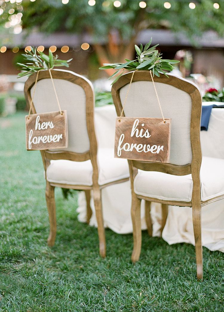 chair signs - photo by Lacie Hansen https://ruffledblog.com/utterly-beautiful-california-wedding-planned-by-the-bride