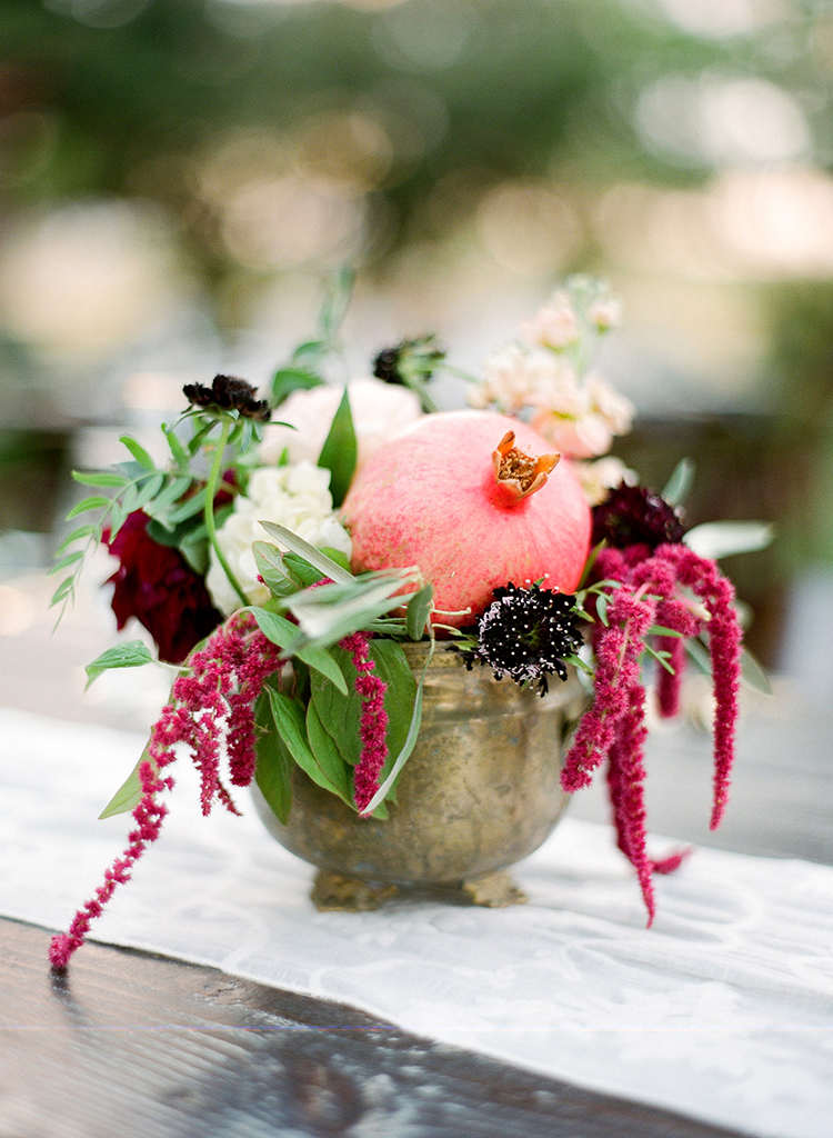 centerpieces with amaranthus and pomegranates - photo by Lacie Hansen http://ruffledblog.com/utterly-beautiful-california-wedding-planned-by-the-bride