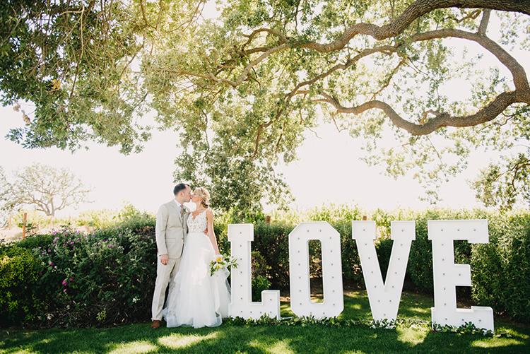 LOVE wedding signs - photo by Fondly Forever Photography https://ruffledblog.com/utterly-dreamy-destination-wedding-in-santa-ynez-valley