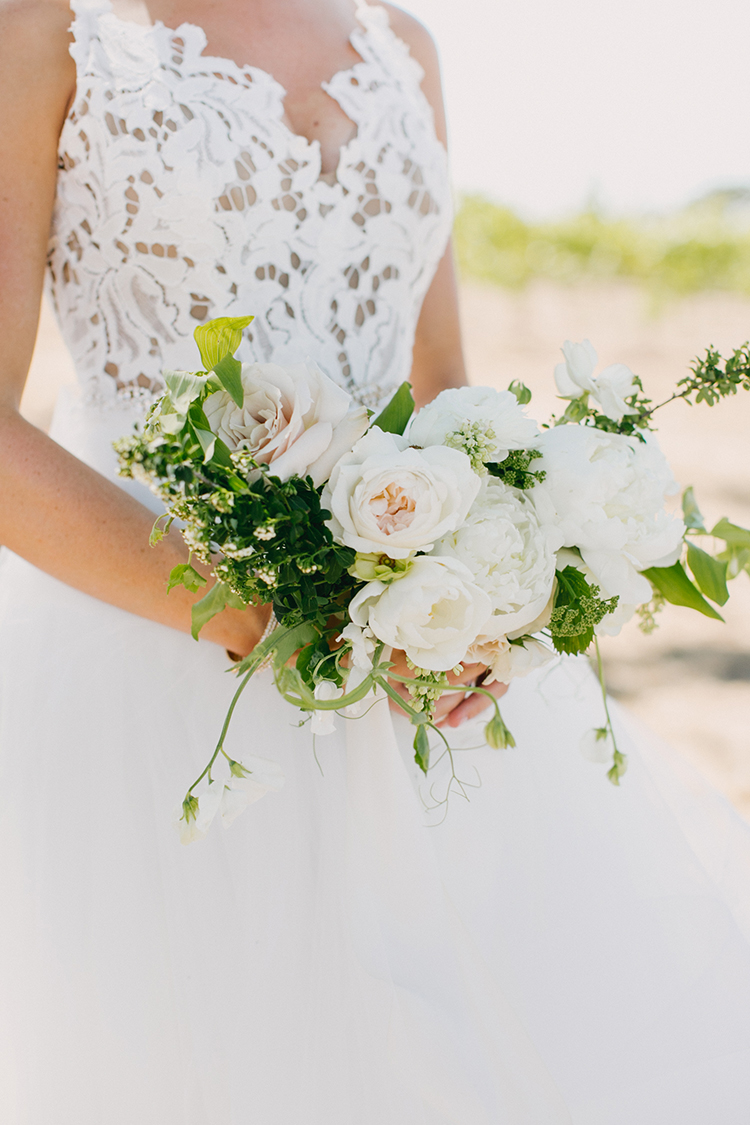 ivory wedding bouquets - photo by Fondly Forever Photography http://ruffledblog.com/utterly-dreamy-destination-wedding-in-santa-ynez-valley